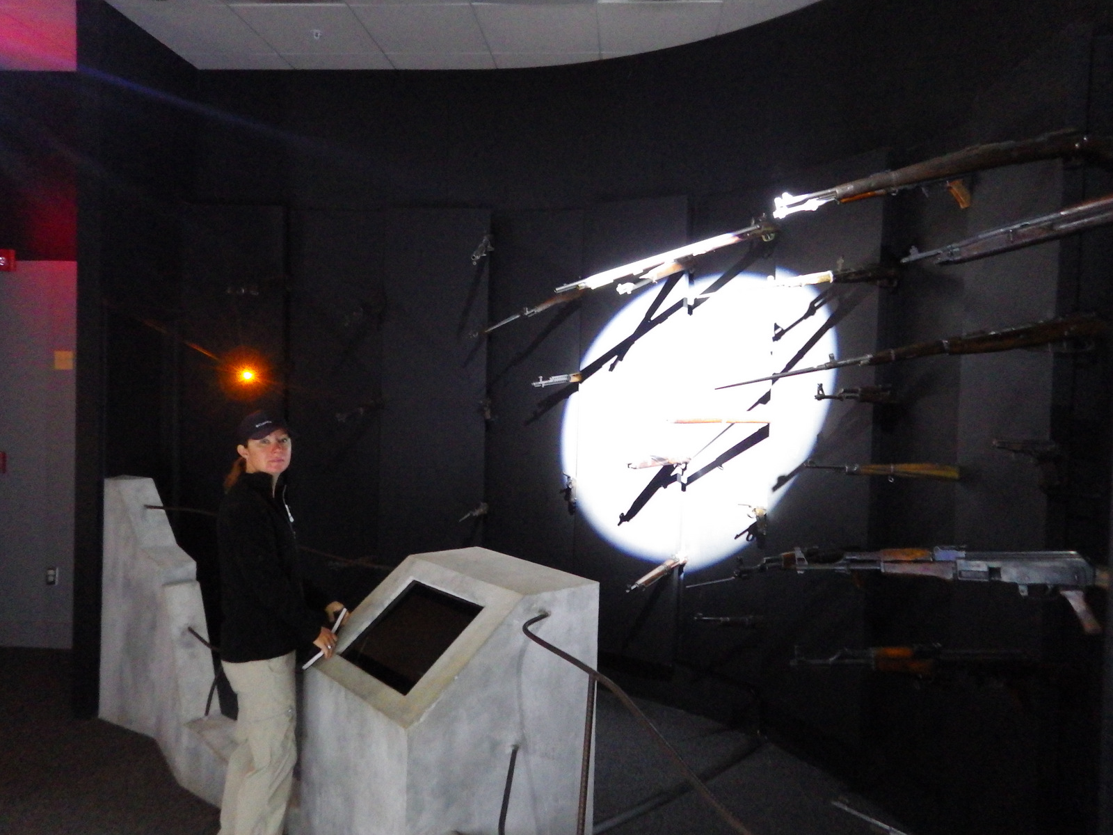 Tiff in the POW museum (those are all guns trained on her)