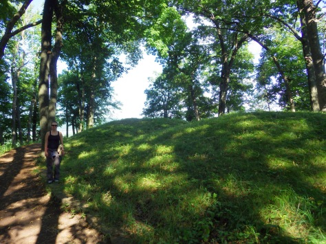 Tiff next to two of the tallest mounds in the park