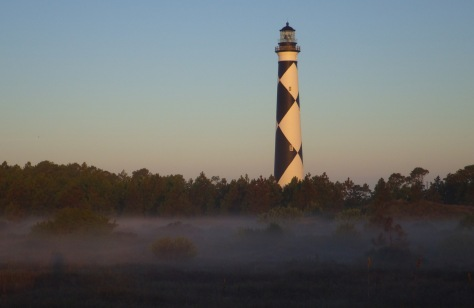 The lighthouse sticking out of the low fog